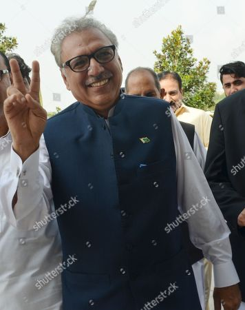 Stock Image of Dr. Arif Alvi, a leader of Pakistan Tahrik-e-Insaf political party that is ruling the country, and a candidate of the Presidential seat, flashes the victory sign as he arrives at the Parliament, during Presidential elections in Islamabad, Pakistan, 04 September 2018. Legislators in both chambers of the Pakistani parliament and the four provincial assemblies voted on September,  to elect the 13th president to replace Mamnoon Hussain. Alvi is expected to win the vote after his party's victory in the July general elections, which saw the party's leader, Imran Khan, become prime minister.