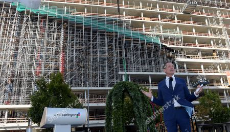 Matthias Doepfner, CEO of Axel Springer, speaks during the topping out of the new Axel Springer building in Berlin, Germany, 04 September 2018. The new building of Axel Springer, one of the biggest digital publishers in Europe that owns various multimedia news brands is designed by Dutch architect Rem Koolhaas.