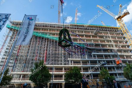 The ring is fixed to a crane during the topping out of the new Axel Springer building in Berlin, Germany, 04 September 2018. The new building of Axel Springer, one of the biggest digital publishers in Europe that owns various multimedia news brands is designed by Dutch architect Rem Koolhaas.