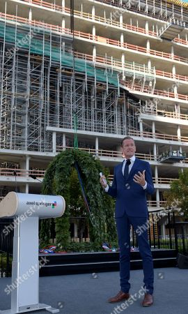 Stock Image of Matthias Doepfner, CEO of Axel Springer, speaks during the roofing ceremony of the new Axel Springer building in Berlin, Germany, 04 September 2018. The new building of Axel Springer, one of the biggest digital publishers in Europe that owns various multimedia news brands is designed by Dutch architect Rem Koolhaas.