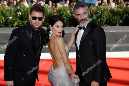 Director Gonzalo Tobal, left, and actors Lali Esposito, centre and Leonardo Sbaraglia, right, pose for photographers upon arrival at the premiere of the film 'Acusada' at the 75th edition of the Venice Film Festival in Venice, Italy, Tuesday, Sept.4, 2018