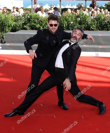 Director Gonzalo Tobal, left, and actor Leonardo Sbaraglia, right, pose for photographers upon arrival at the premiere of the film 'Acusada' at the 75th edition of the Venice Film Festival in Venice, Italy, Tuesday, Sept.4, 2018