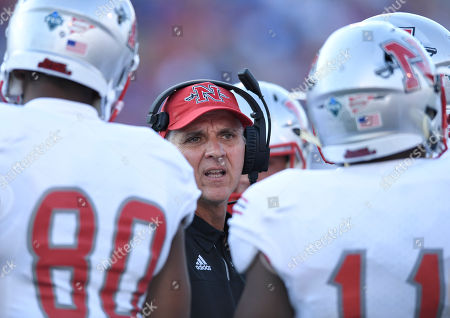 Nicholls State head coach Tim Rebowe talks to his team during the first quarter of an NCAA college football game against Kansas in Lawrence, Kan