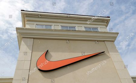 """A Nike logo is displayed outside a Nike store in Charlotte, N.C., . Colin Kaepernick has a new deal with Nike, even without having a job in the NFL. Kaepernick's attorney, Mark Geragos, made the announcement on Twitter, calling the former San Francisco 49ers quarterback an """"All American Icon"""" and crediting attorney Ben Meiselas for getting the deal done"""