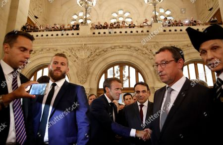 French President Emmanuel Macron (C) arrives with the President of the Central Jewish Consistory of Paris Joel Mergui (C-R) at the Great Synagogue to attend a ceremony that marks the Jewish New Year, in Paris, France, 04 September 2018.