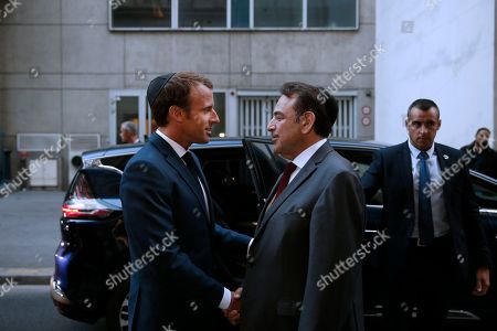 President of the Central Jewish Consistory of Paris Joel Mergui (C) greets French President Emmanuel Macron (L) upon his arrival at the Great Synagogue to attend a ceremony that marks the Jewish New Year, in Paris, France, 04 September 2018.