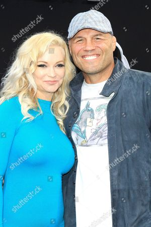 US actress Mindy Robinson (L) and US actor/wrestler Randy Couture (R) arrive at the world premiere of 'The Nun' at the TCL Chinese Theatre IMAX in Los Angeles, California, USA, 04 September 2018. The movie opens in the USA on 07 September 2018.