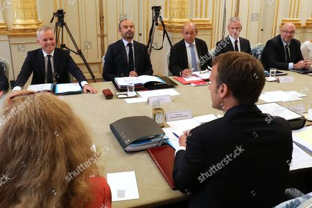 Newly appointed French Minister for the Ecological and Inclusive Transition Francois de Rugy (L) takes part in his first weekly cabinet meeting with French Prime Minister Edouard Philippe (rear, C), French Foreign Affairs Minister Jean-Yves Le Drian (3-R), French Economy Minister Bruno Le Maire (2-R), French Agriculture Minister Stephane Travert (R) and President Emmanuel Macron (front, C) at the Elysee Palace in Paris, France, 05 September 2018, following a government reshuffle the day before. President Emmanuel Macron unveiled his new ministerial cabinet on 04 September 2018, following the resignation of France's sports minister and French Minister for the Ecological and Inclusive Transition.