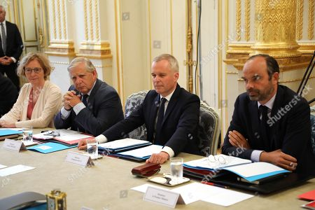 French Minister for the Ecological and Inclusive Transition Francois de Rugy (2-R), flanked with French Prime Minister Edouard Philippe, French Labour Minister Muriel Penicaud (L) and French Minister for the Territorial Cohesion Jacques Mezard (2-L), looks on during his first weekly cabinet meeting at the Elysee Palace in Paris, France, 05 September 2018, following a government reshuffle the day before. President Emmanuel Macron unveiled his new ministerial cabinet on 04 September 2018, following the resignation of France's sports minister and French Minister for the Ecological and Inclusive Transition.