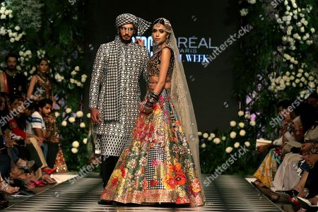 Models present creations by Pakistani designer Nomi Ansari, on the first day of Pakistan Fashion Design Council (PFDC) L'Oreal Bridal Week in Lahore, Pakistan, 04 September 2018 (issued 05 March 2018). The event runs through 04 to 06 September.