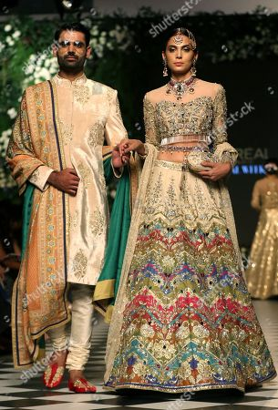 Stock Photo of Models present creations by Pakistani designer Nomi Ansari, on the first day of Pakistan Fashion Design Council (PFDC) L'Oreal Bridal Week in Lahore, Pakistan, 04 September 2018 (issued 05 March 2018). The event runs through 04 to 06 September.
