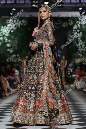 A model presents a creation by Pakistani designer Nomi Ansari, on the first day of Pakistan Fashion Design Council (PFDC) L'Oreal Bridal Week in Lahore, Pakistan, 04 September 2018 (issued 05 March 2018). The event runs through 04 to 06 September.