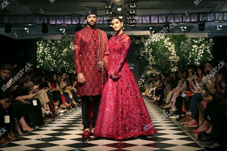 Stock Image of Models present creations by Pakistani designer Nomi Ansari, on the first day of Pakistan Fashion Design Council (PFDC) L'Oreal Bridal Week in Lahore, Pakistan, 04 September 2018 (issued 05 March 2018). The event runs through 04 to 06 September.