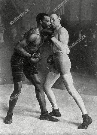 Stock Image of Bob Fitzsimmons (1863-1917) British Boxer V Bob Armstrong (1873-1933) American Boxer in A Boxing Match. . Unattributed Photograph