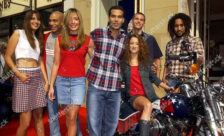 10/4/02 Nephew Of Us President George Bush George P.bush (centre Checked Shirt) Opens A New Tommy Hilfiger Store In Manchester's King Street With TV Presenter Cat Deeley (red Top Centre Left) Leah Wood (seated On Bike) Daughter Of  Ronnie Wood And Sonja Kinski (left White Top) Daughter Of Actress Nastassja Kinski And Rolan Bolan (far Right Checked Shirt) Son Of Pop Star Marc Bolan