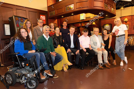 Stock Picture of Nicky Campbell in the Rovers Return Pub with members of the cast of Coronation Street, including Cherylee Houston, Connie Hyde, Daniel Brocklebank, Faye Brookes, Katie McGlynn, Liam Bairstow, Melanie Hill, Nicola Thorpe, Tristan Gemmill, William Roache