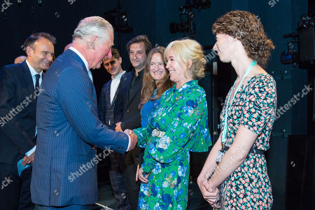 Prince Charles meets Sally Greene (centre) onstage at the Old Vic Theatre, in central London, during a visit to mark the theatre's 200th anniversary.