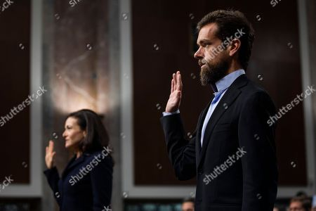 CEO of Twitter Jack Dorsey (R) and COO of Facebook Sheryl Sandberg (L) are sworn-in before testifying at a Senate Intelligence Committee hearing on 'foreign influence operations and their use of social media platforms' in the Dirksen Senate Office Building in Washington, DC, USA, 05 September 2018. Lawmakers are expected to ask the top executives what measures they are implementing to protect their online content from Russian propaganda and political censorship.  (Google) Larry Page was invited to testify but did not show.