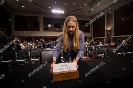 A Senate staffer places a name placard for Google CEO Larry Page, was invited to testify but did not show, to testify before a Senate Intelligence Committee hearing on 'foreign influence operations and their use of social media platforms' in the Dirksen Senate Office Building in Washington, DC, USA, 05 September 2018. Lawmakers did get to question COO of Facebook Sheryl Sandberg and CEO of Twitter Jack Dorsey.