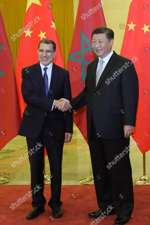 Chinese President Xi Jinping (R) shakes hands with Moroccan Prime Minister Saadeddine Othmani before a meeting in Beijing, China, 05 September 2018.