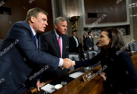 Senate Intelligence Committee Vice Chairman Mark Warner, D-Va., left, and Chairman Sen. Richard Burr, R-N.C., center, shake hands with Facebook COO Sheryl Sandberg after Senate Intelligence Committee hearing on 'Foreign Influence Operations and Their Use of Social Media Platforms' on Capitol Hill, in Washington