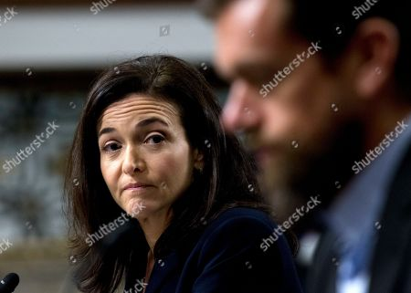 Facebook COO Sheryl Sandberg accompanied by Twitter CEO Jack Dorsey, right, before the Senate Intelligence Committee hearing on 'Foreign Influence Operations and Their Use of Social Media Platforms' on Capitol Hill, in Washington. Google CEO did not show for the hearing