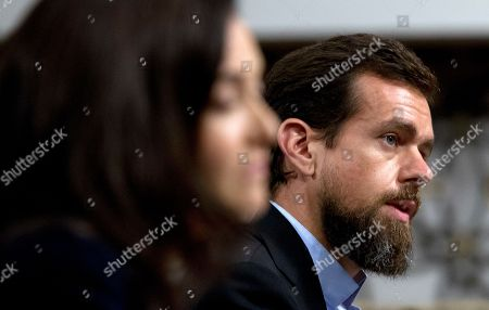 Twitter CEO Jack Dorsey accompanied by Facebook COO Sheryl Sandberg, left, testify before the Senate Intelligence Committee hearing on 'Foreign Influence Operations and Their Use of Social Media Platforms' on Capitol Hill, in Washington