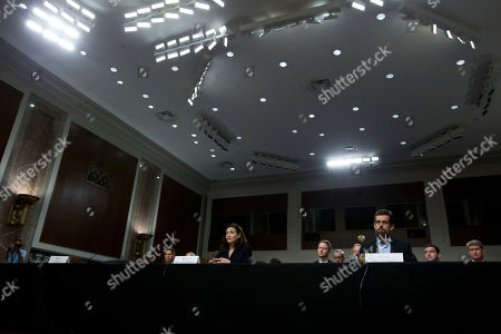 Facebook COO Sheryl Sandberg accompanied by Twitter CEO Jack Dorsey testify before the Senate Intelligence Committee hearing on 'Foreign Influence Operations and Their Use of Social Media Platforms' on Capitol Hill, in Washington. Far left is an empty chair reserved to Google CEO who did not show for the hearing