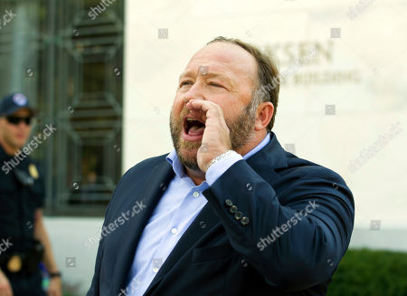 Conspiracy theorist Alex Jones speaks outside of the Dirksen building of Capitol Hill after listening to Facebook COO Sheryl Sandberg and Twitter CEO Jack Dorsey testify before the Senate Intelligence Committee on 'Foreign Influence Operations and Their Use of Social Media Platforms' on Capitol Hill, in Washington