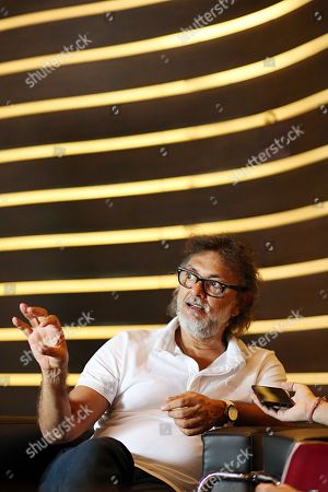 Stock Picture of Rakeysh Omprakash Mehra during the promotion of his upcoming movie Fanney Khan at Le Meridien hotel