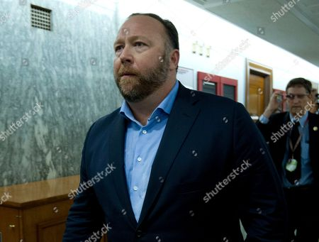 Alex Jones, the right-wing conspiracy theorist, walks the corridors of Capitol Hill after listening to Facebook COO Sheryl Sandberg and Twitter CEO Jack Dorsey testify before the Senate Intelligence Committee on 'Foreign Influence Operations and Their Use of Social Media Platforms' on Capitol Hill, in Washington