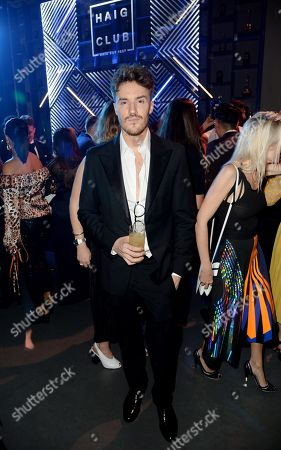 James Stewart enjoys Haig Club cocktails at the GQ Men of the Year Awards 2018 at Tate Modern in London