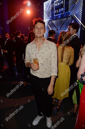 Jimmy Hill enjoys Haig Club cocktails at the GQ Men of the Year Awards 2018 at Tate Modern in London