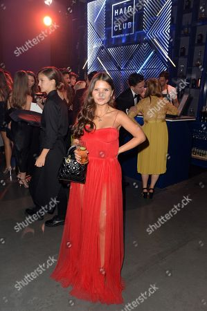 Millie Cotton enjoys Haig Club cocktails at the GQ Men of the Year Awards 2018 at Tate Modern in London