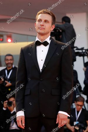 Actor Anders Danielsen Lie poses for photographers upon arrival at the premiere of the film '22 July' at the 75th edition of the Venice Film Festival in Venice, Italy