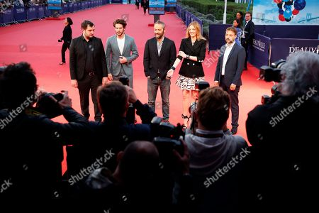 Members of the jury, (L-R) French actor Karim Leklou, French actor Francois Civil, French screenwriter Cedric Kahn, French actress Kate Moran and French screenwriter Hubert Charuel arrive on the red carpet prior to the premiere of 'Adrift' during the 44th Deauville American Film Festival, in Deauville, France