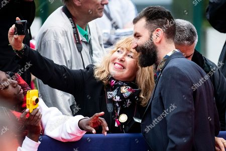US director Jeremiah Zagar takes a picture with a person from the public as he arrives on the red carpet prior to the premiere of 'Adrift' during the 44th Deauville American Film Festival, in Deauville, France