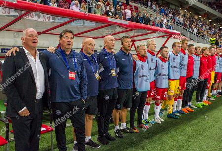 Denmark's coach John Jensen (L) sings the national anthem before the international friendly soccer match between Slovakia and Denmark, at the Antona Malatinskeho Stadium, in Trnava, Slovakia, 05 September 2018.