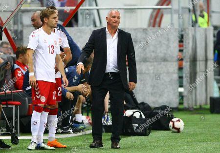 Stock Photo of Denmark's coach John Jensen (R) reacts next to player Adam Fogt during the international friendly soccer match between Slovakia and Denmark, at the Antona Malatinskeho Stadium, in Trnava, Slovakia, 05 September 2018.