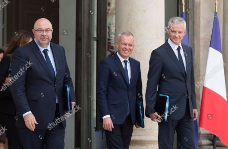 French Agriculture Minister Stephane Travert, French Ecological and Social Transition Minister Francois de Rugy and French Economy Minister Bruno Le Maire leave after the weekly cabinet meeting