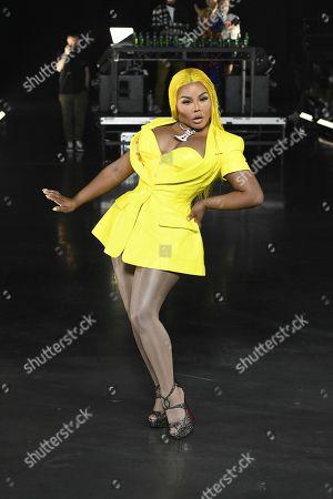 Lil Kim on the catwalk
