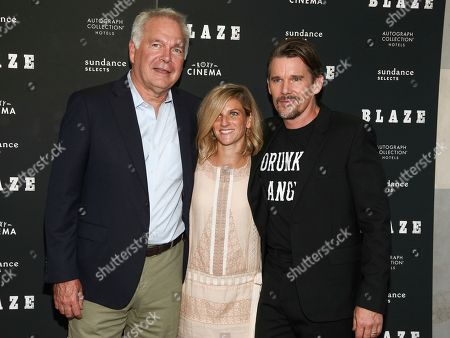 "Jonathan Sehring, Ryan Shawhughes, Ethan Hawke. Jonathan Sehring, from left, Ryan Shawhughes and Ethan Hawke attend a special screening of ""Blaze"" at the IFC Center, in New York"