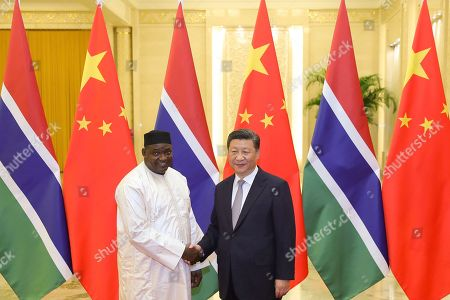 Chinese President Xi Jinping, right, shakes hands with Gambian President Adama Barrow at the Great Hall of the People in Beijing
