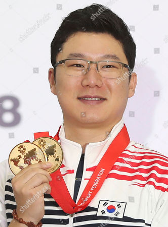 Jin Jong-oh of South Korea poses for a photo with his gold medals during the medal ceremony at the International Shooting Sport Federation World Championship in Changwon, South Korea, 06 September 2018. Jin won the men's 10-meter air pistol event after combining with countrymen Lee Dae-myung and Han Seung-woo for the 10-meter air pistol team gold medal the same day.