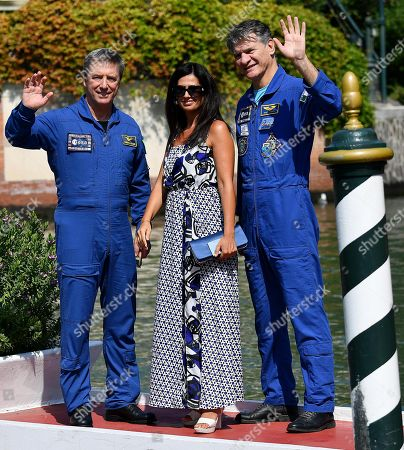 Italian astronauts Paolo Nespoli (R) and Roberto Vittori (L) with Italian director Alessandra Bonavina (C) arrive at the Lido Beach for the 75th annual Venice International Film Festival, in Venice, Italy, 06 September 2018. The festival runs from 29 August to 08 September.