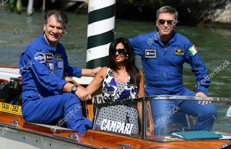 Stock Photo of Italian astronauts Paolo Nespoli (L) and Roberto Vittori (R) with Italian director Alessandra Bonavina (C) arrive at the Lido Beach for the 75th annual Venice International Film Festival, in Venice, Italy, 06 September 2018. The festival runs from 29 August to 08 September.