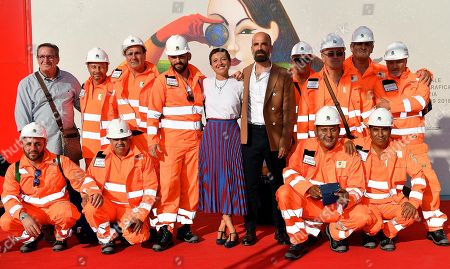 Italian directors Massimo D'Anolfi (C-R) and Martina Parenti (C-L) with workers involved in the excavation of the Milan Metro arrive for the premiere of the short movie 'Blu' during the 75th annual Venice International Film Festival, in Venice, Italy, 06 September 2018. The movie is presented in the official competition 'Venezia 75' at the festival running from 29 August to 08 September.