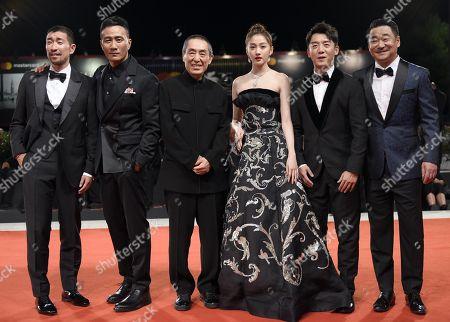 Stock Picture of (L-R) Chinese actors Wang Qianyuan, Hu Jun, Chinese filmmaker Zhang Yimou, Chinese actors Guan Xiaotong, Zheng Kai and Wang Jingchun