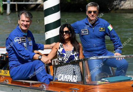Italian astronauts Paolo Nespoli (L) and Roberto Vittori (R) with Italian director Alessandra Bonavina (C) arrive at the Lido Beach for the 75th annual Venice International Film Festival, in Venice, Italy, 06 September 2018. The festival runs from 29 August to 08 September.