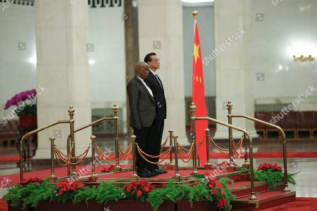 Chinese Premier Li Keqiang (R) and Prime Minister of Lesotho, Thomas Motsoahae Thabane (L) listen to their national anthems during a welcoming ceremony inside the Great Hall of the People in Beijing, China, 06 September 2018.